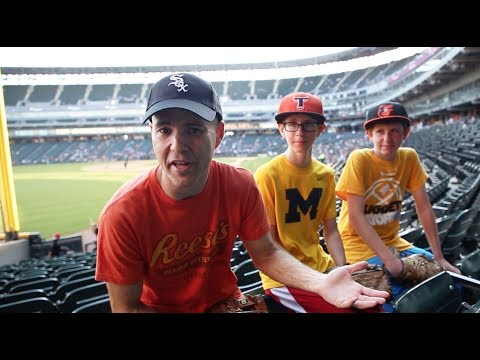 Helping two kids catch baseballs at Guaranteed Rate Field