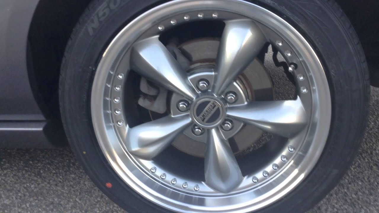 """2006 Ford Mustang sitting on 18"""" American Muscle Rims wrapped in 245"""