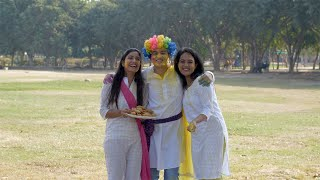 Young cheerful teenagers in traditional clothing celebrating Holi festival in India