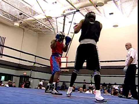 Cedric Johnson of A-Square Fight Club vs Tyrome Jones of St James Boxing Club