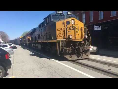GOTTA SEE THIS.....FREIGHT TRAIN ROLLING DOWN MAIN STREET.....AMAZING!