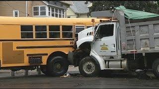 Holyoke P.D. cite dump truck driver in bus crash