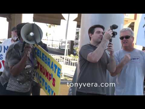 protesters against President. Donald Trump  meet protesters that love Donald Trump at LAX