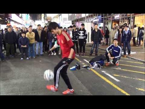 Amazing Football Acrobatics. Street Performers in Hong Kong