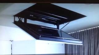 Video cadillac deville 2001 25 flip down tv tview for Motorized ceiling tv mounts for flat screens