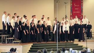 An International musical team(choir) sings an African,Zambian song