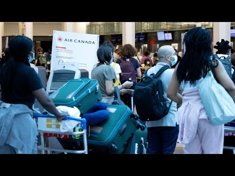 Travellers at Montreal's Trudeau airport react to Canada's border reopening plan