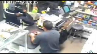 New York shopkeeper chases armed robber with machete - CCTV video