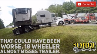 That could have been worse. 18 wheeler almost misses trailer.