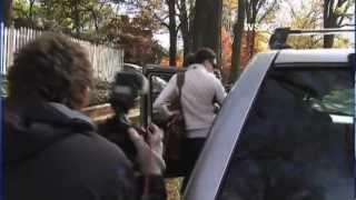 Paula Broadwell hits photographer with car door