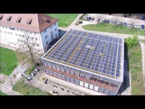 Drone movie of a roof top solar power plant in Switzerland