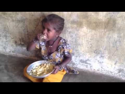 Slum girl enjoying her egg meal