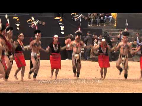 Phom Naga tribes-men dressed scantily and dancing merrily, Nagaland Travel Video