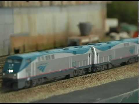 N Scale KATO Amtrak Passenger Train rolls past N Scale Steel Mills.
