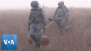 Rebels Remove Mines in Eastern Ukraine After Troops Withdraw