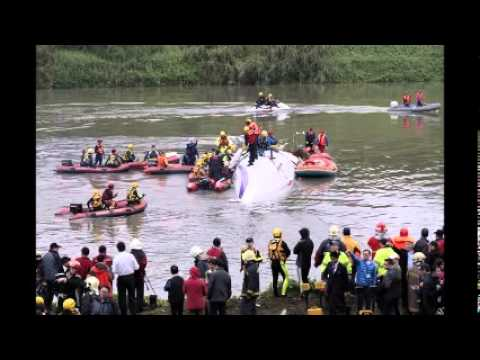 At least 23 dead as Taiwan plane plunges into river