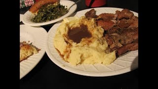 Country Smothered Pork chops n gravy, collard greens, cornbread, mashed potatoes