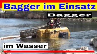 Excavator in action - CAT excavator sunk in the river!