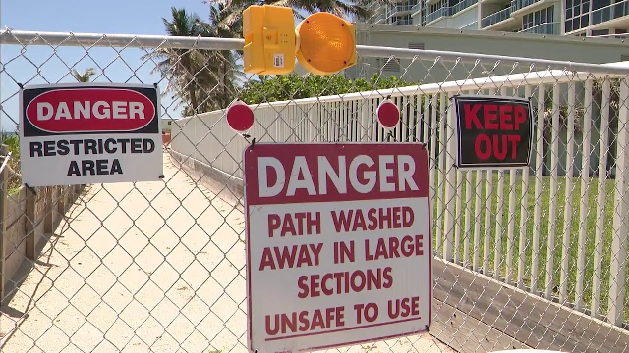 "Public pathway blocked by ""Danger"" signs put up by beachside condo"