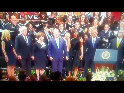 President Obama and former President George W. Bush laugh and dance at Dallas Officers Memorial