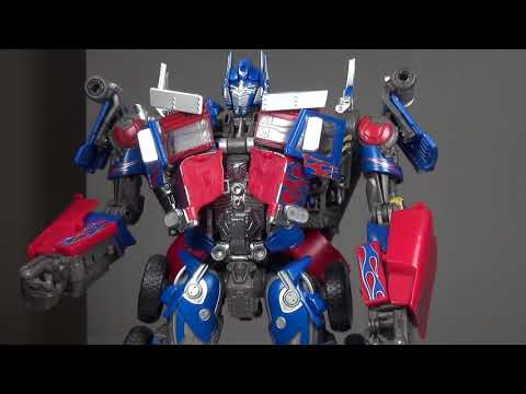 MPM-4 Masterpiece Movie Optimus Prime transformation guide both modes & review