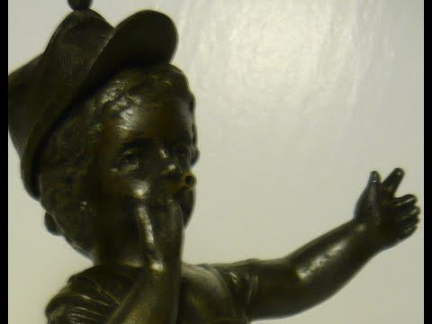 This antique bronze drummer boy sculpture statue is from the civil war era