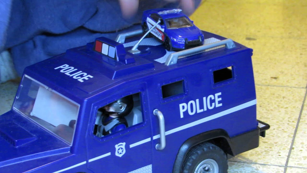 all my kids toys benaya plays with his new playmobil police car
