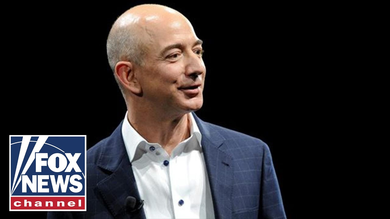 Jeff Bezos accuses National Enquirer publisher of