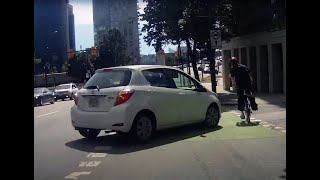 Lady drives her car down bike lane - Almost seriously injures a cyclist.