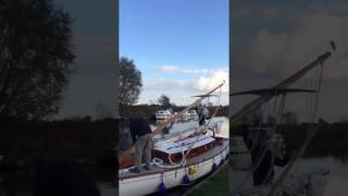 Lowering the mast on a traditional Norfolk Broads sailing yacht. oliverssailingholidays.co.uk