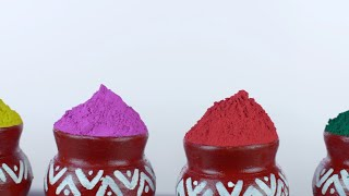 Closeup shot of vibrant Gulal colors against the white background - Holi festival