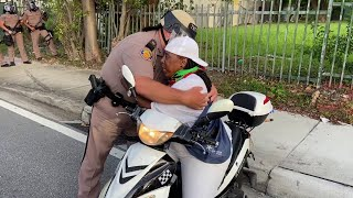 Trooper breaks the line to hug woman at Miami protests