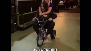 Nia Jax And Alexa Bliss ride a tricycle