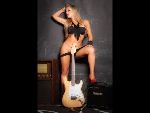 nude black girl with a guitar