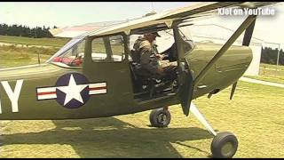 A full-sized Cessna Bird Dog visits the airfield