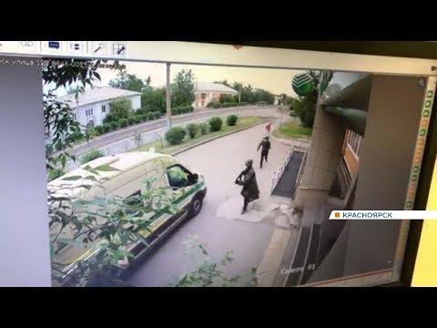 В Красноярске неизвестные в масках расстреляли инкассаторов и украли деньги: репортаж