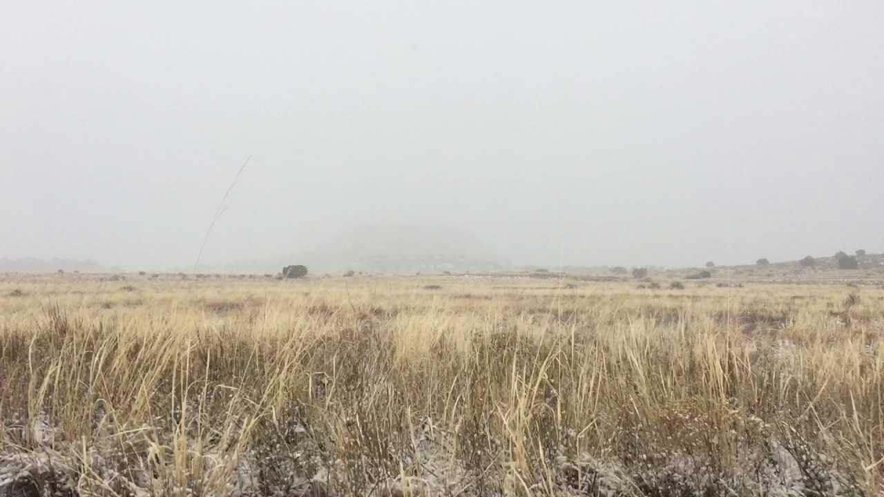 Pov From Moving Car Of Snow Falling In Canyonlands Utah - Free Stock Footage