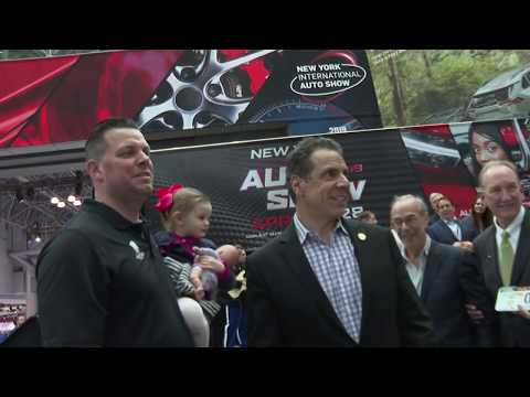 Andrew Cuomo arrives at the New York International Auto Show in style