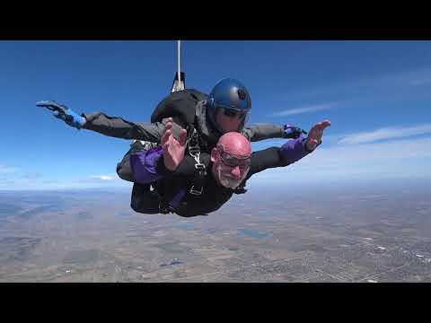 JOHNNY SCOVILLE EATING GUINNESS RECORD CAROLINA REAPERS DURING A SKYDIVE!!!
