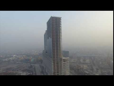 Aerial stock footage India under construction yet huge building in Noida