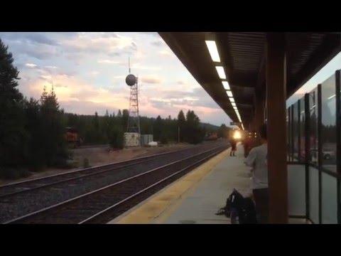 Union Pacific Freight Train Speeding Through Amtrak Station