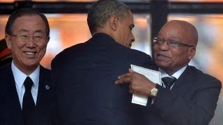 Crowds cheer Obama, heckle Zuma