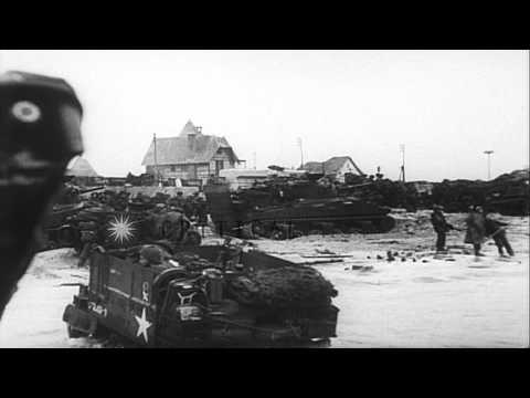 British troops landing at Sword Beach on D-Day.  And US troops landing at Omaha B...HD Stock Footage