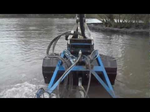 Two Truxors excavating and dredging silt with clamshell bucket