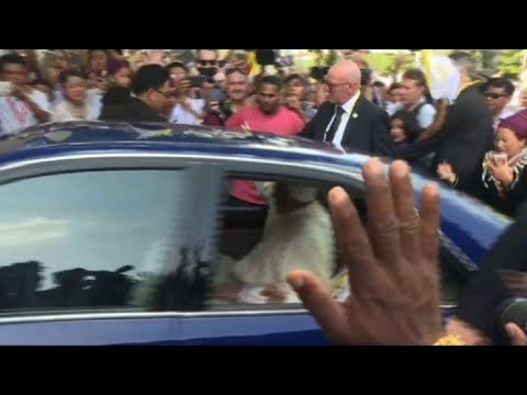 Pope arrives at the Archbishop's residence in Yangon