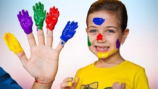 Playing finger paints to song Family Colors