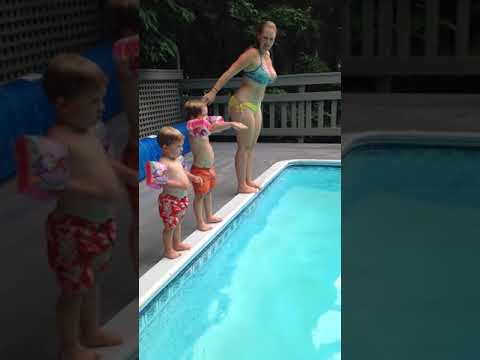 Child Does a Spectacular Belly-Flop into the Pool