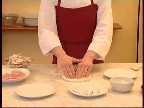 cuisine-italienne---pizza-au-jambon-et-aux-champignons-(regina)