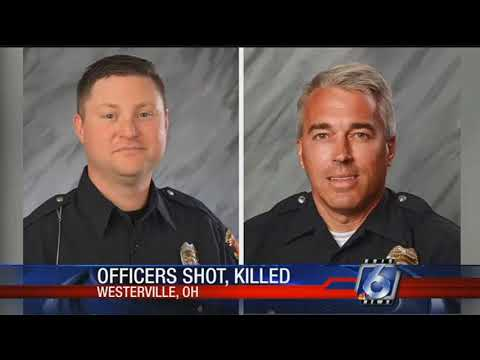 Police: 2 officers killed responding to 911; suspect held