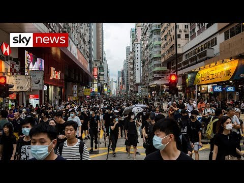 hong-kong-protesters-throw-chinese-flag-into-harbour-in-latest-stand